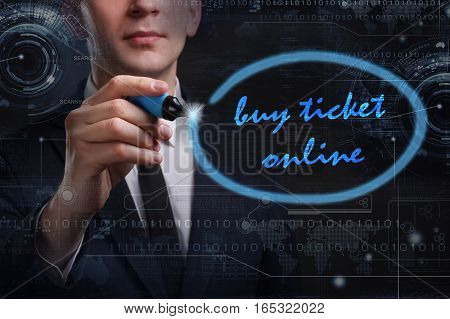 Business, Technology, Internet And Network Concept. Young Business Man Writing Word: Buy Ticket Onli