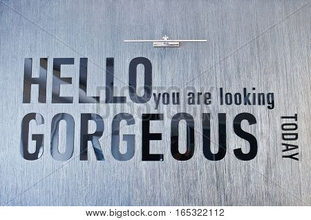 Shiny Sign Hello You Are Looking Gorgeous, Mounted On Glossy Marble Wall.