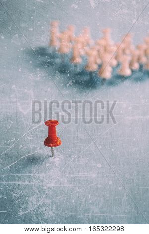 thumbtacks pinned arrange to symbolize on wooden table to be different or leadership or bravery with copy space, vintage tone