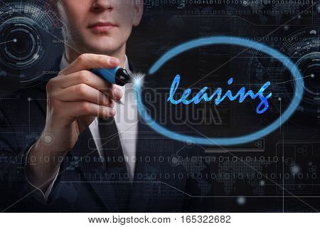 Business, Technology, Internet And Network Concept. Young Business Man Writing Word: Leasing