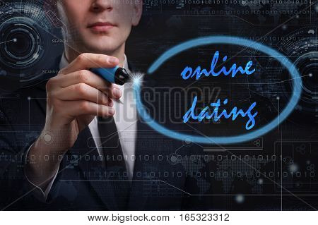 Business, Technology, Internet And Network Concept. Young Business Man Writing Word: Online Dating