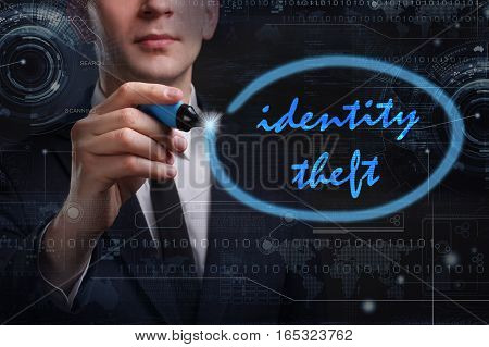 Business, Technology, Internet And Network Concept. Young Business Man Writing Word: Identity Theft