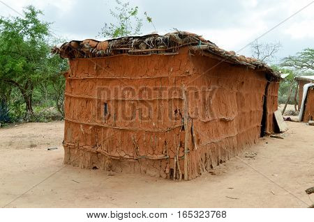 Traditional house of masai in earth and wood in a village of Kenya
