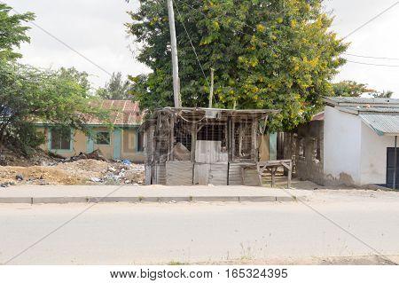 Old wooden hut and trellis on the way from Mombassa to Nairobi