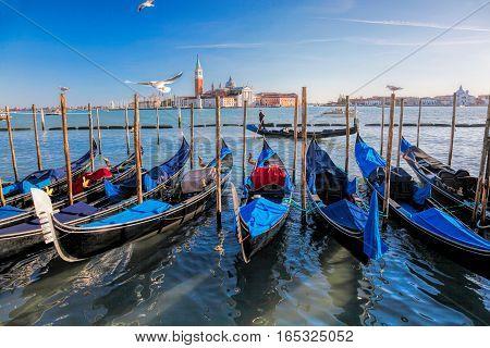 Gondolas In Venice Against San Giorgio Maggiore Church In Italy
