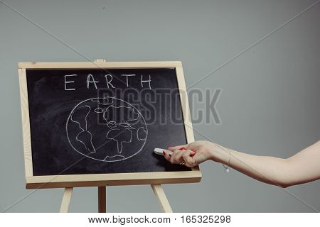 Earth Written On Blackboard With Earth Symbol, Background, High Resolution