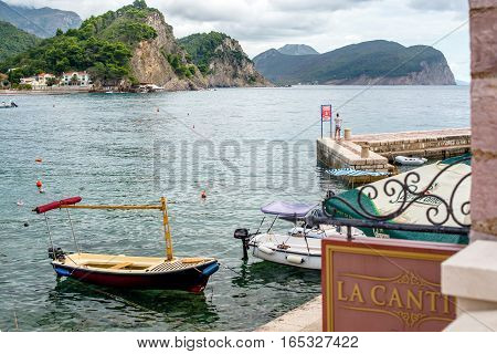 PETROVAC, MONTENEGRO - SEPTEMBER 20, 2016:Bay of Petrovac with boats and pier, Montenegro.