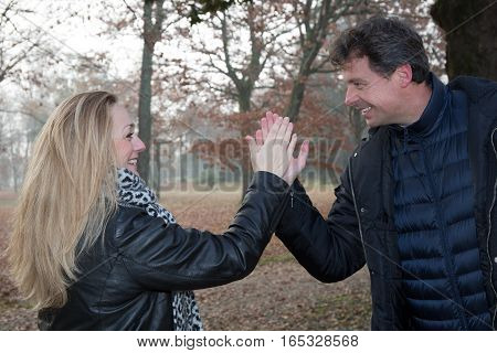 A Man And A Woman Clap In The Hand, She Is Blonde