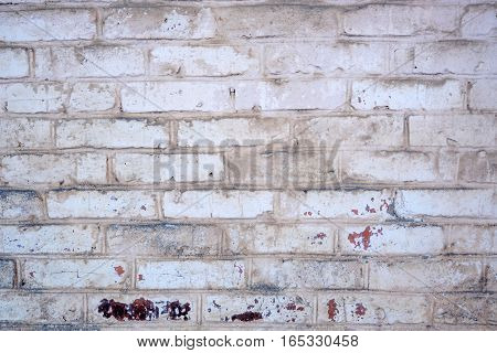 Old wall of stone gray, black and white bricks textured background