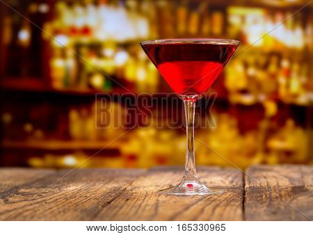 Red Cocktail On Wooden Table