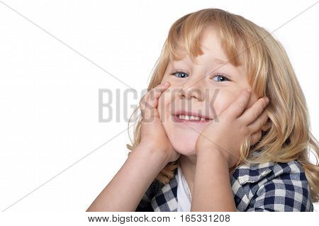 Portrait of happy little boy with long blond hair looking at  camera