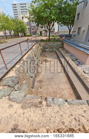 FUKUI JAPAN - AUGUST 02 2016: Excavated site of former Kitanosho castle in Fukui Japan. Castle was founded in 1575 but burnt down when Shibata Katsue lost the Battle of Shizugatake in 1583
