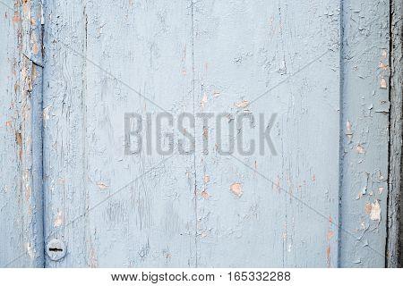Old door. Castle. Cracked blue paint. wall