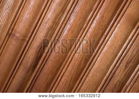 Texture of wooden diagonal planks with some spaces between them