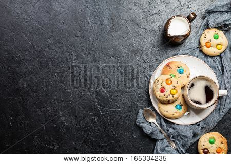 Homemade Candy Coated Chocolate Chip Cookies on black background, top view with copy space
