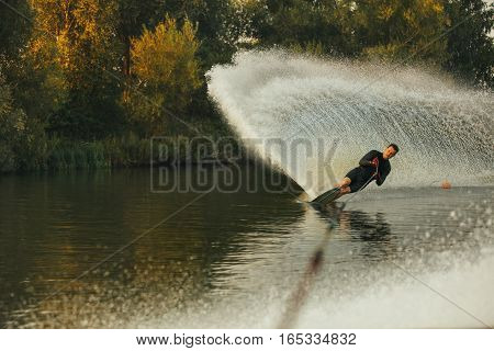 Wakeboarder In Action On The Lake