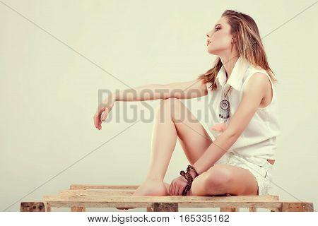 Girl Posing In Studio In Fashion Style