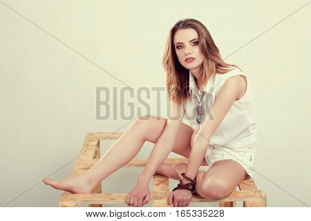 Woman Posing In Fashion Style In Studio On White Background