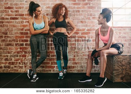 Three Young Friends Talking After Fitness Training