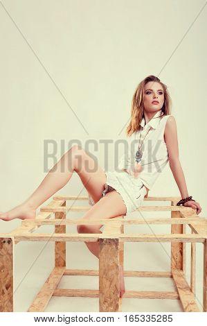 Woman In White Mini Shorts And Shirt Posing In Studio