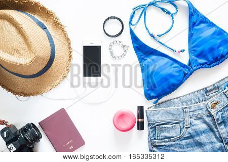 Set of summer items. Girl essentials with mobile phone camera and passport for beach vacation on white background