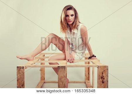 Girl In White Mini Shorts And Shirt Posing In Studio