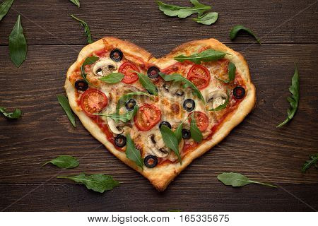 Tasty Italian Heart Shaped Pizza With Chicken, Mushrooms And Scattered Arugula's Leaves On Wooden Ru