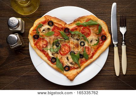Tasty Hot Pizza In Heart Shape With Chicken And Mushrooms And Cutlery On Wooden Table.
