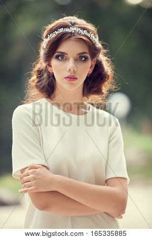 Beautiful Woman In White Shirt In Park On Green Natural Background