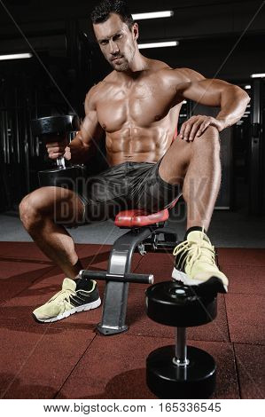 Man With Weight Training In Gym Equipment Sport Club