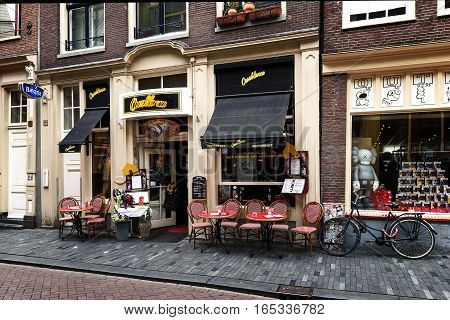 AMSTERDAM NETHERLANDS - JULY 7 2016: Typical street in The Nine Streets - special neighbourhood is full with vintage and designer shopping speciality stores and cozy cafes Amsterdam.