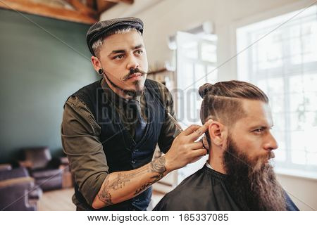 Bearded Man Getting Haircut By Barber
