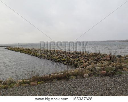 Low breakwater on Flensburg Fjord protecting Holiday Marina