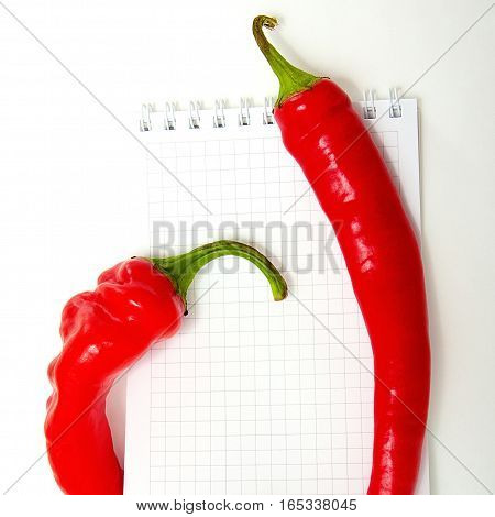 Red Chili On Open Notebook