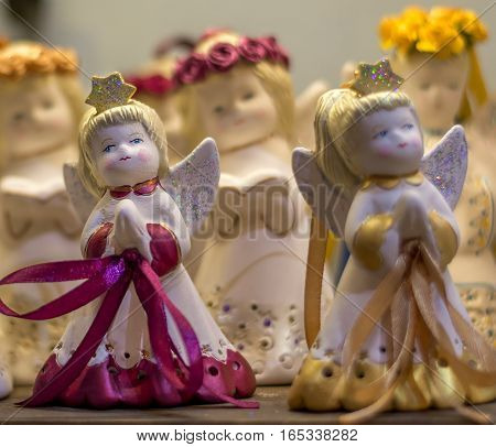 Abstract - figure of small angels girls singing Christmas song - decoration close up