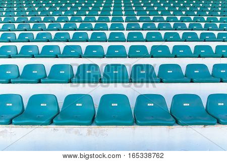 green bench or chair in the stadium.