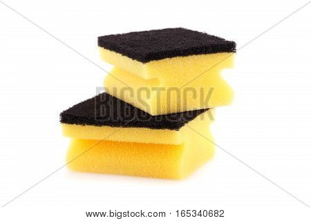 Two sponges isolated on a white background.