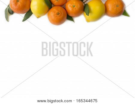 Mandarins and lemons on white background. Tangerines with lemons at border of image with copy space for text. Top view.
