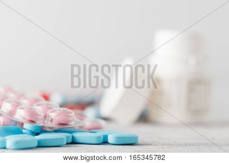 Pile Of Medical Pills On Wooden Table