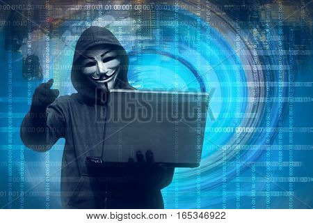 Hooded Man With Mask Holding Laptop