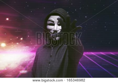 Hooded Man With Vendetta Mask Grabbing Something