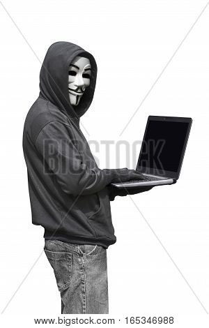 Hooded Man With Mask Typing On Laptop