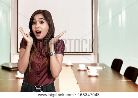 Beautiful Asian Business Woman With Shocked Facial Expression