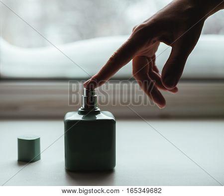 female Perfume blue bottle with female hand