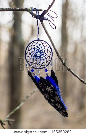 black and blue Dreamcatcher made of feathers leather beads and ropes hanging