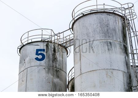 Industrial silos. Tall and with external staircase