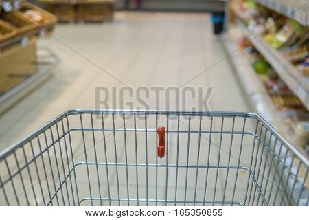 Empty shopping cart in supermarket. Shopping concept.