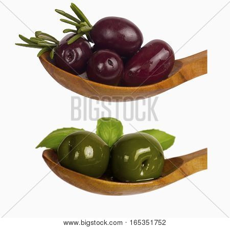 green and red olives over spoon isolated on white