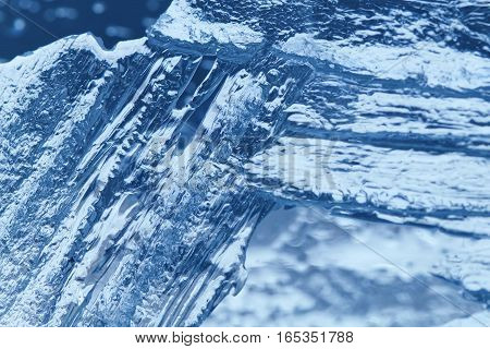 Ice background textured. frozen ice surface of a lake. macro soft focus.