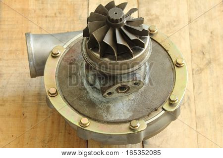 Close-up of old turbocharger on the wood